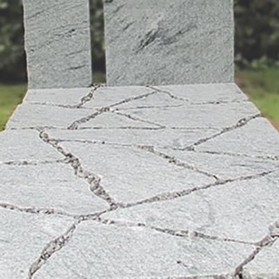 Bewerking branden grafsteen